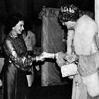 The Queen of England greeting Dame Edna. Dame Edna's Web site.
